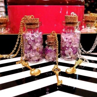 """Cork Vial Necklace by Best Kept Secret Jewelry. Amethyst & Citrine, when worn together, increase happiness in relationships. Amethyst promotes love, spiritual wisdom, and intuition. It enhances memory and improves motivation. Citrine encourages happiness and generosity while attracting money into your life.  1/2'' Vial w/ Amethyst & Citrine Nuggets, Gold Best Kept Secret Key Charm, 30"""" Gold Chain"""