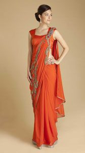 Gaurav Gupta  Chiffon Metal Loop Sari  Orange georgette sari with zari and dabka metal work. Antique silver brocade border with chain metal loops on pallav. Paired with stretch satin blouse with pleated shoulder strap with metal brooch embellishment at the back. Side zip closure. Includes stretch lycra petticoat with drawstring and concealed zip closure.