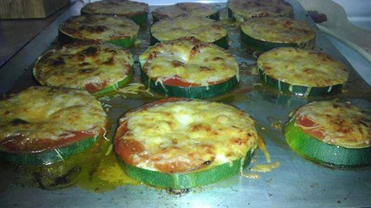 Sliced zucchini, pizza sauce and toppings! Place on oiled baking pan, baked at 450 for about 15 min