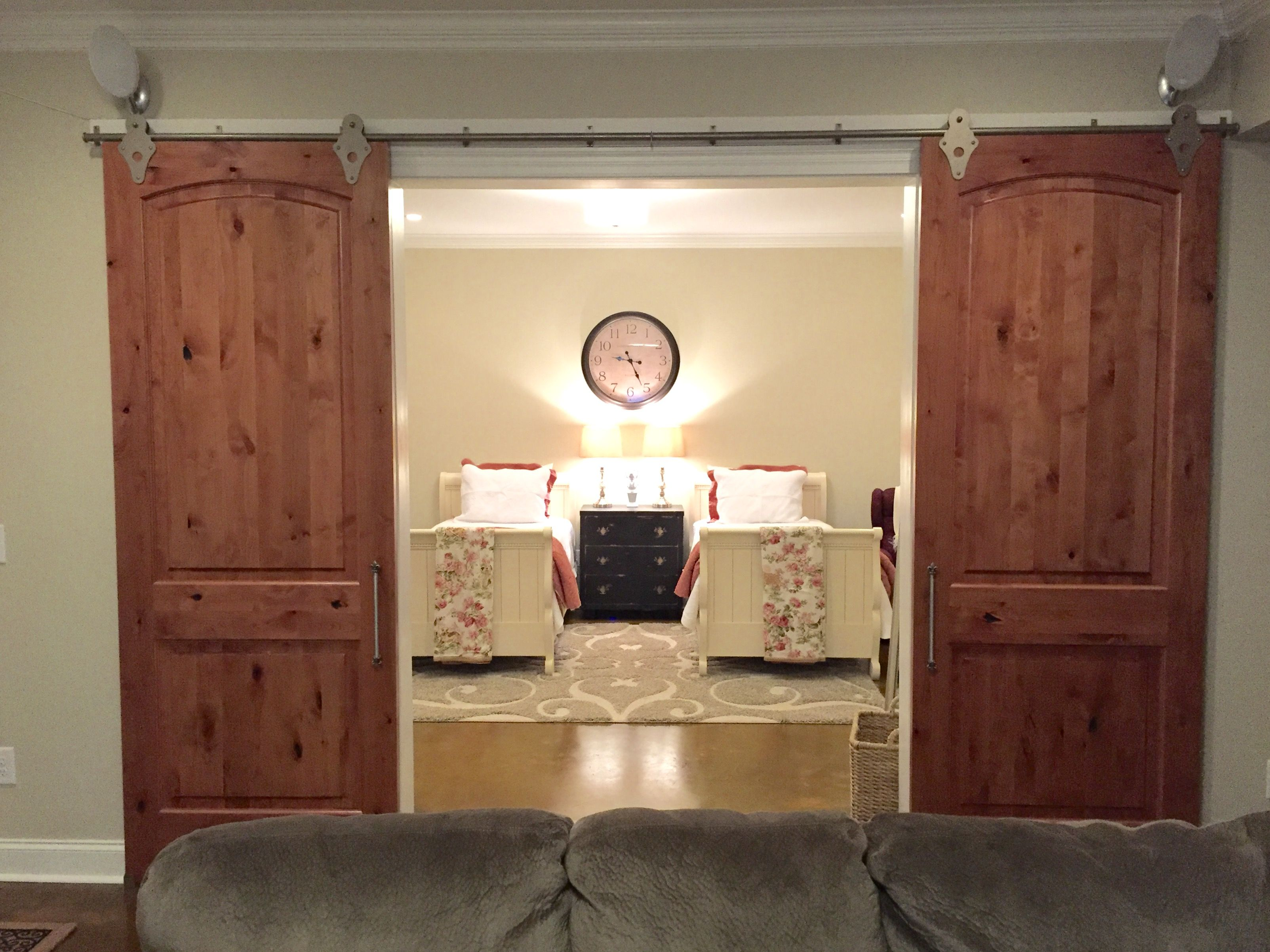 Guest Suite Barn Doors Manchester Tan Walls Stained Concrete