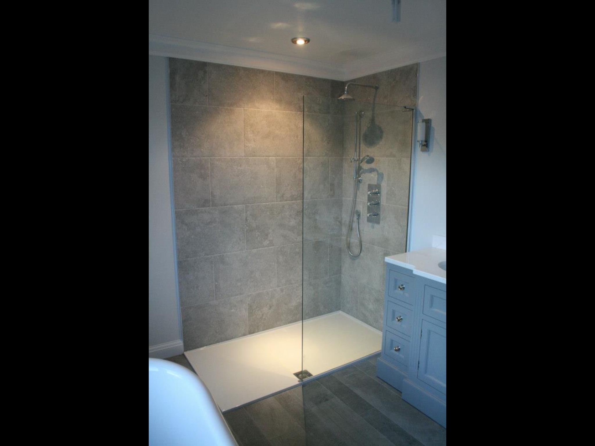 Gorgeous luxury matki shower with tiles from porcelanosa for Bathroom designs kent