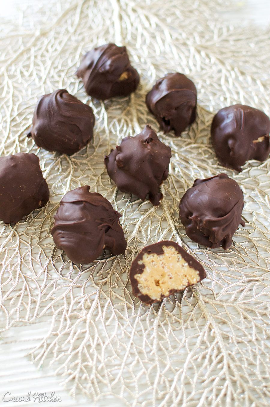 These Festive Chocolate Peanut Butter Balls with shredded coconut and rice krispies are the perfect bite-sized treat for the holidays. | Crumb Kitchen #peanutbutterballswithricekrispies