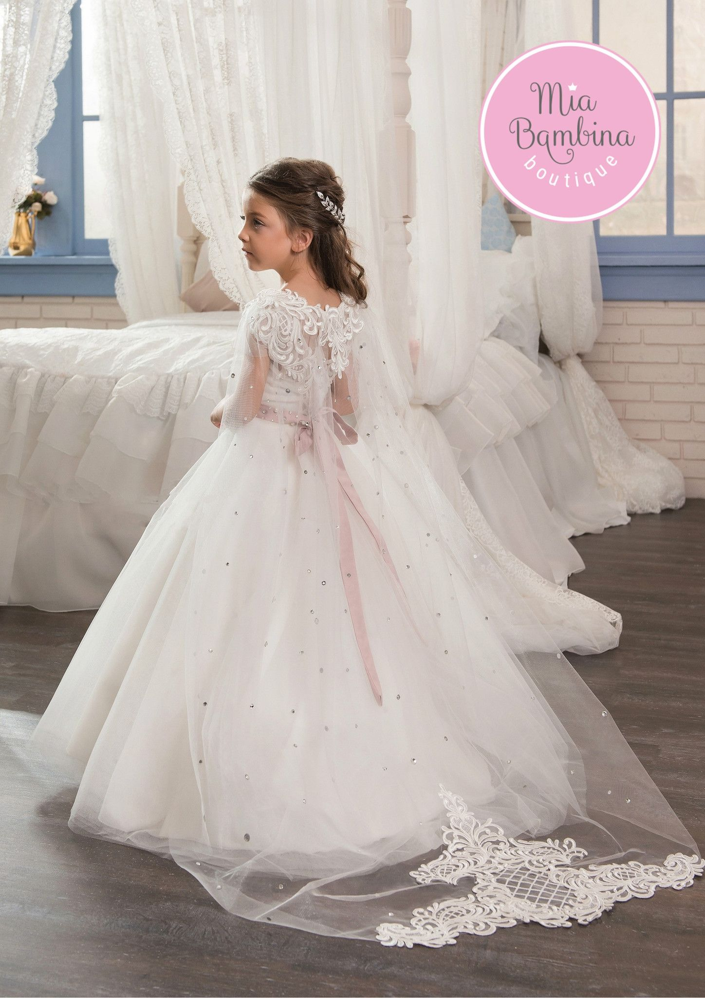 631197dcc30 The Colorado flower girl dress is a beautiful A-line dress with a  detachable cape. A fitted open back bodice with short sheer sleeves and a  long full tulle ...
