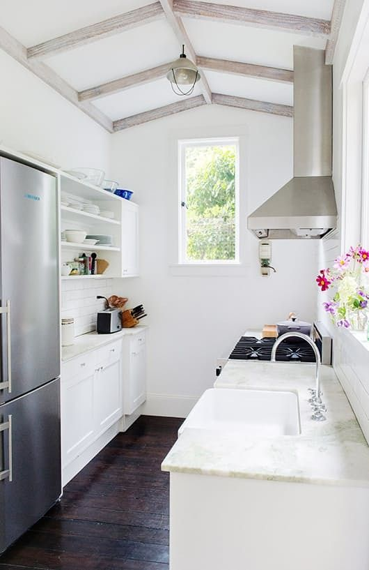 Make It Work: 9 Smart Design Solutions for Narrow Galley ... Galley Kitchen Decor Ideas on dining room decor ideas, galley kitchen trends, sun room decor ideas, loft decor ideas, galley kitchen accessories, galley kitchen living room, galley kitchen organization, master suite decor ideas, shower decor ideas, galley kitchen pinterest, enclosed porch decor ideas, galley bathroom design ideas, galley kitchen remodel, galley kitchen cabinets, garden decor ideas, utility room decor ideas, galley kitchen islands, foyer decor ideas, bath decor ideas, breakfast area decor ideas,