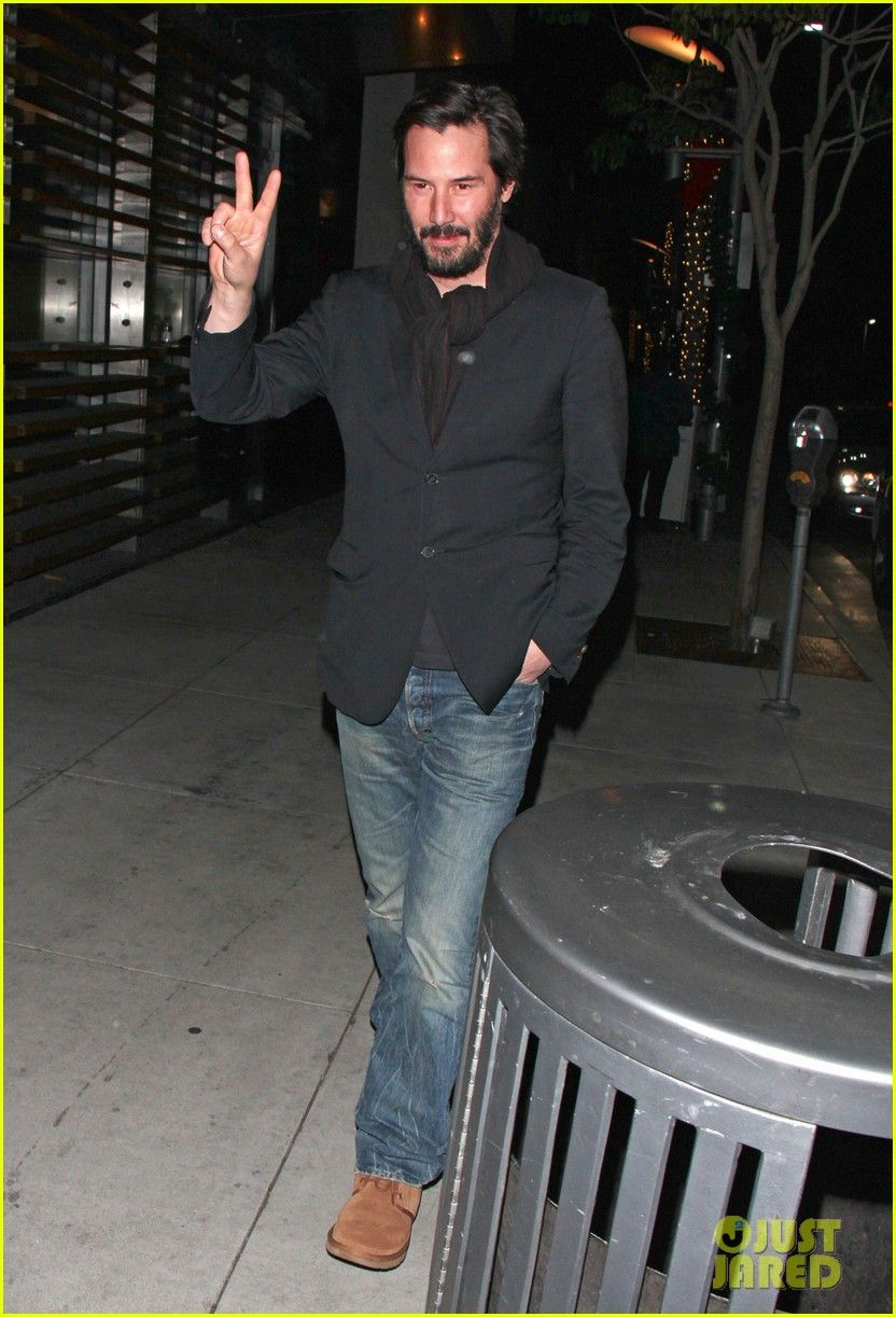 Keanu Reeves Flashes A Peace Sign While Leaving Spago Restaurant Following Dinner With Friends On Sunday December 30 In Beverly Hills Calif