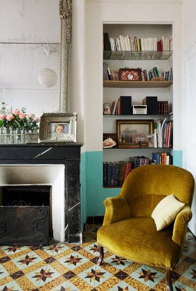 Find an inspiration piece and design around that piece. Love this mustard yellow velvety chair mixed with the blue backdrop wall.