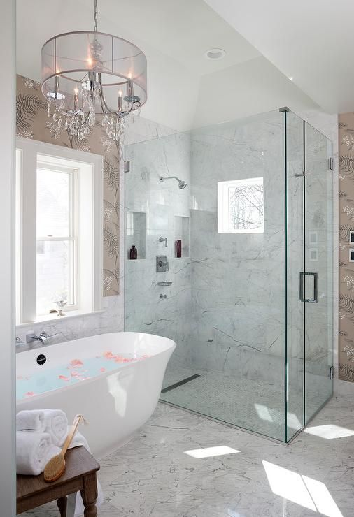 Spa Like Bathroom Features Marble Floor Tiles That Lead To An Freestanding Oval Bathtub Positioned Beneath Spa Style Bathroom Bathroom Styling Bathroom Design