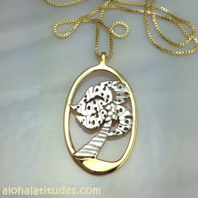 """Sterling silver Aloha Latitudes palm tree pendant with a classic oval gold frame.  The Hawaiian greeting of """"ALOHA"""" is in each branch of the palm."""