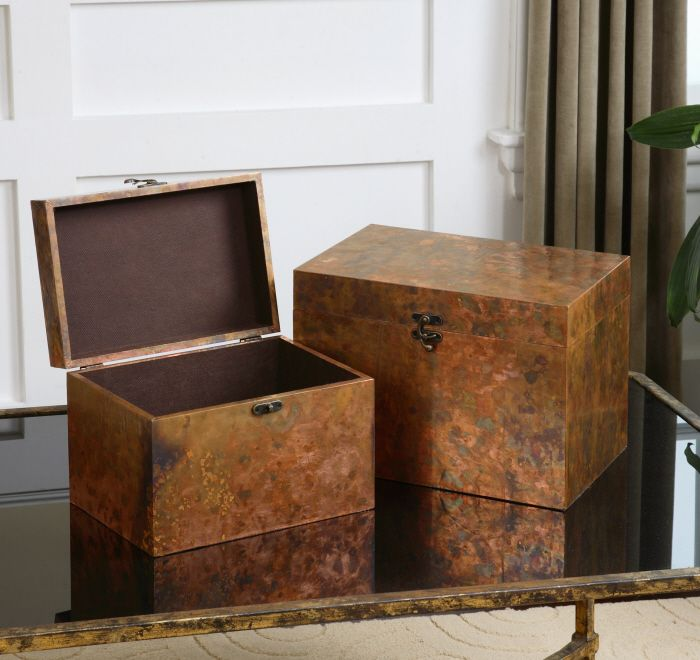 Oxidized copper sheeting. The oxidation on each piece will vary due to their handcrafted nature. Lids are hinged. Sizes: Sm-12x8x8, Lg-14x10x10 Designer: Grace Feyock