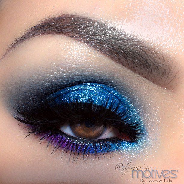 Create this Blue Look with Motives Lid/Motives Paint Pot Mineral Eye Shadow in Glamour  Outer V/ Motives Pressed Eye Shadow in Onyx  Crease and Blending/Motives Presses Eye Shadow in Twilight  Tear duct/Motives Pressed Eye Shadow in Crystal Blue  Lower lash line/ Smudged Motives Gel Eyeliner in Amethyst   on the outer corner of lower lash line with Motives Pressed Eye Shadow in Fantasy followed by Motives Paint Pot Mineral Eye Shadow in Glamour  Liner/Motives Gel Eyeliner in Little Black…