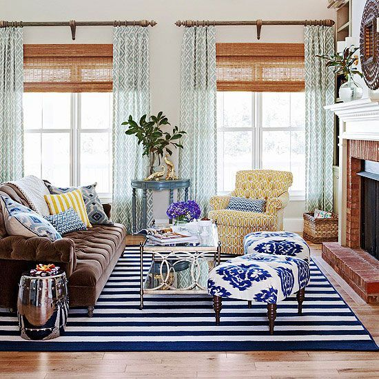 "Even as an accent, indigo has a ""use it now, love it later"" mentality. Infuse it as an accent in a room where you are already using shades of blue. Use patterns that pair indigo with white, such as this striped rug and ikat fabric, for extra style points./"