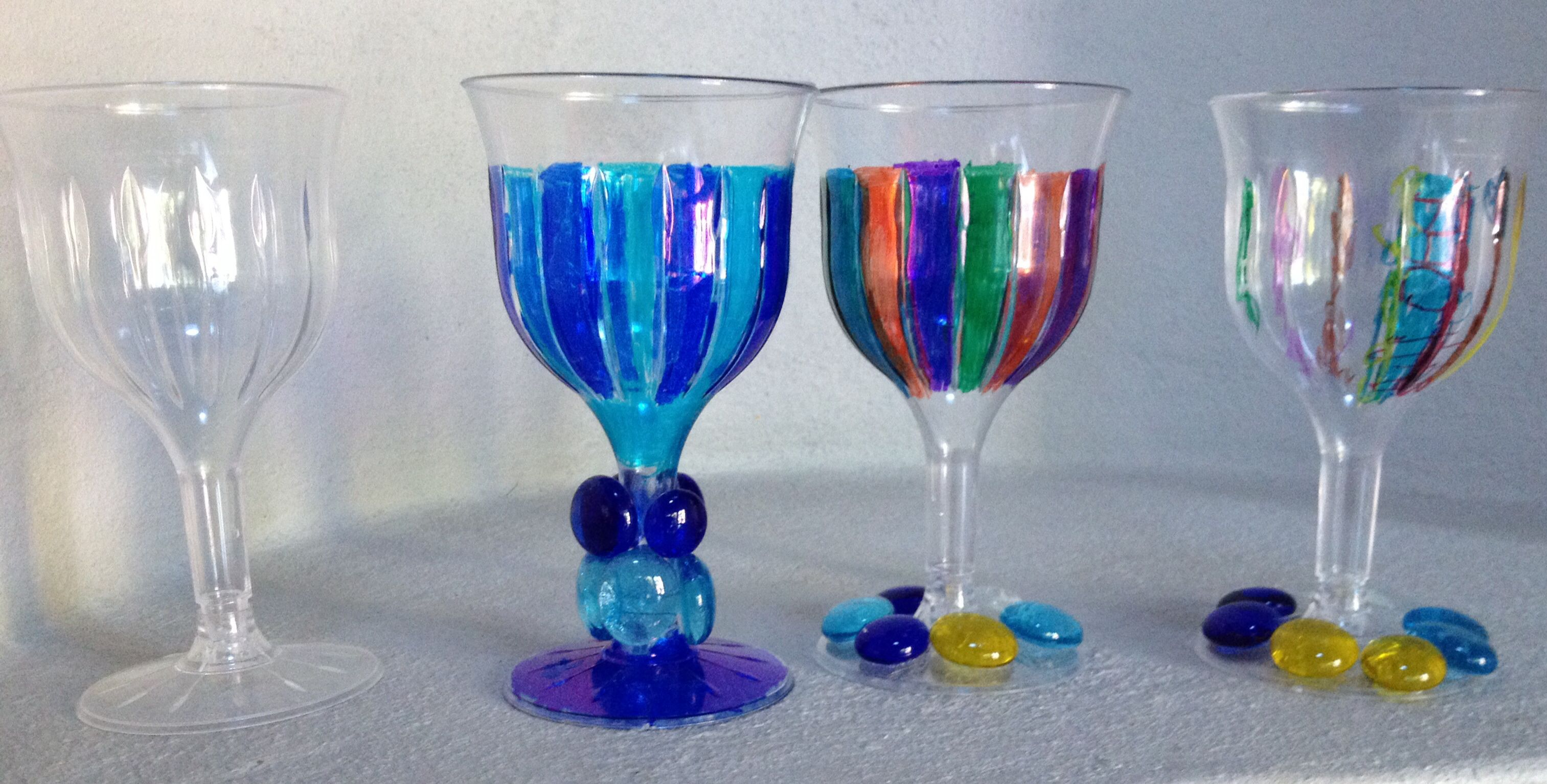 Passover wine goblets: plastic cups, sharpies, mosaic beads and glue.