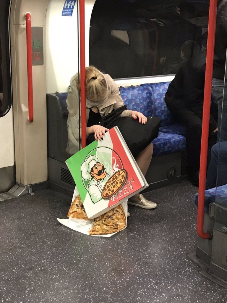 This Photo Of A Sleeping Girl And Her Pizza Is Going Viral