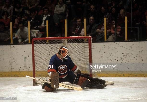 Goalie Billy Smith Of The New York Islanders Makes The Kick Save An