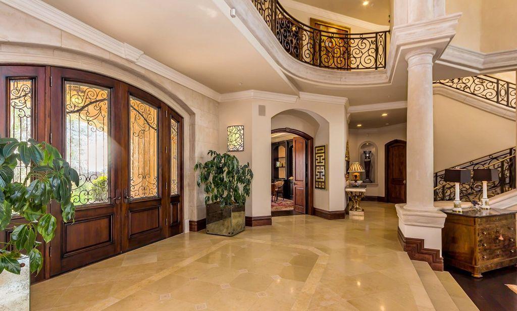 Mediterranean Entryway With High Ceiling Columns Crown