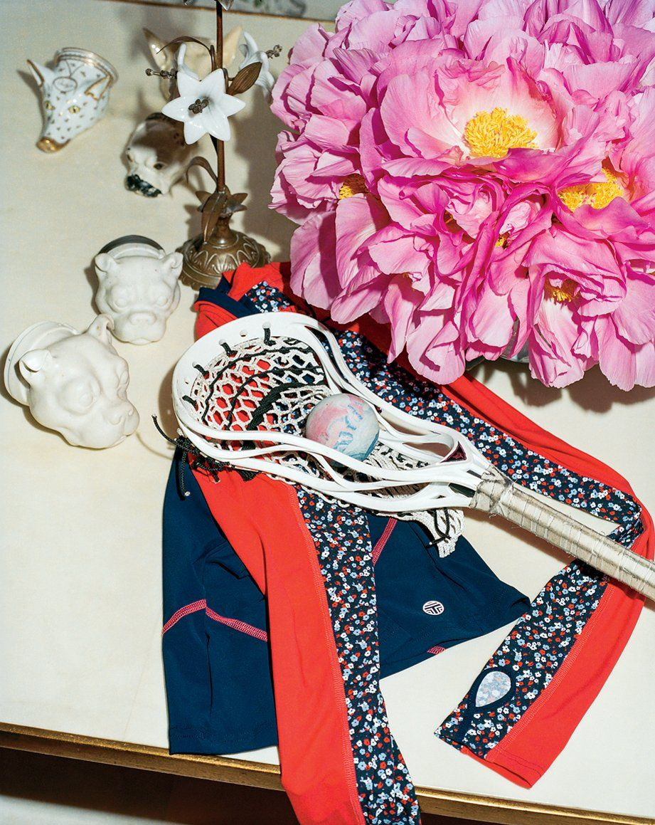 This Sporting Life - An ensemble of a Tory Sport rashguard, lacrosse stick, antique stirrup cups, and peonies.