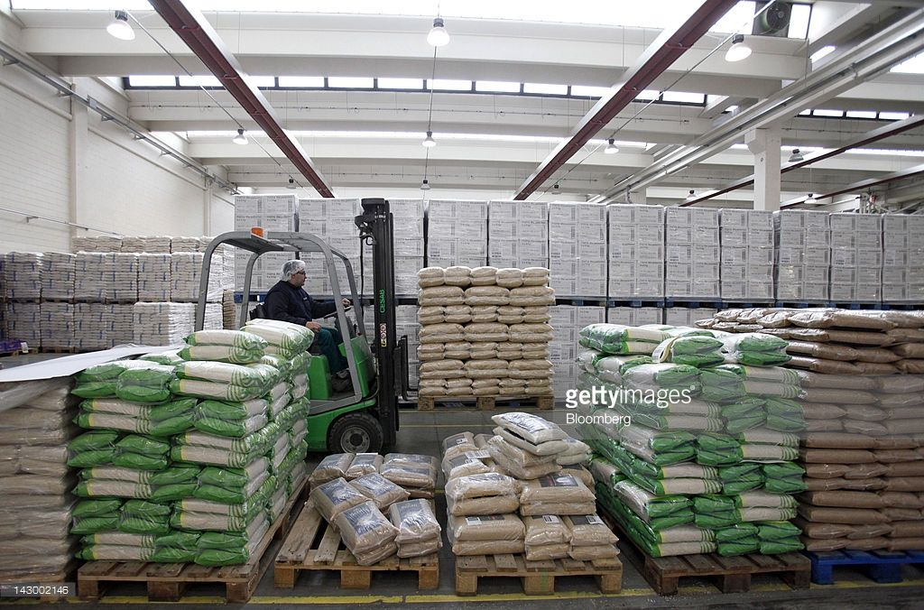 an-employee-uses-a-forklift-truck-to-maneuver-a-pallet-load-of-bagged-picture-id143002146 (1024×676)
