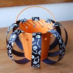 A pumpkin shaped Halloween treat bucket that uses only a few cheap materials!