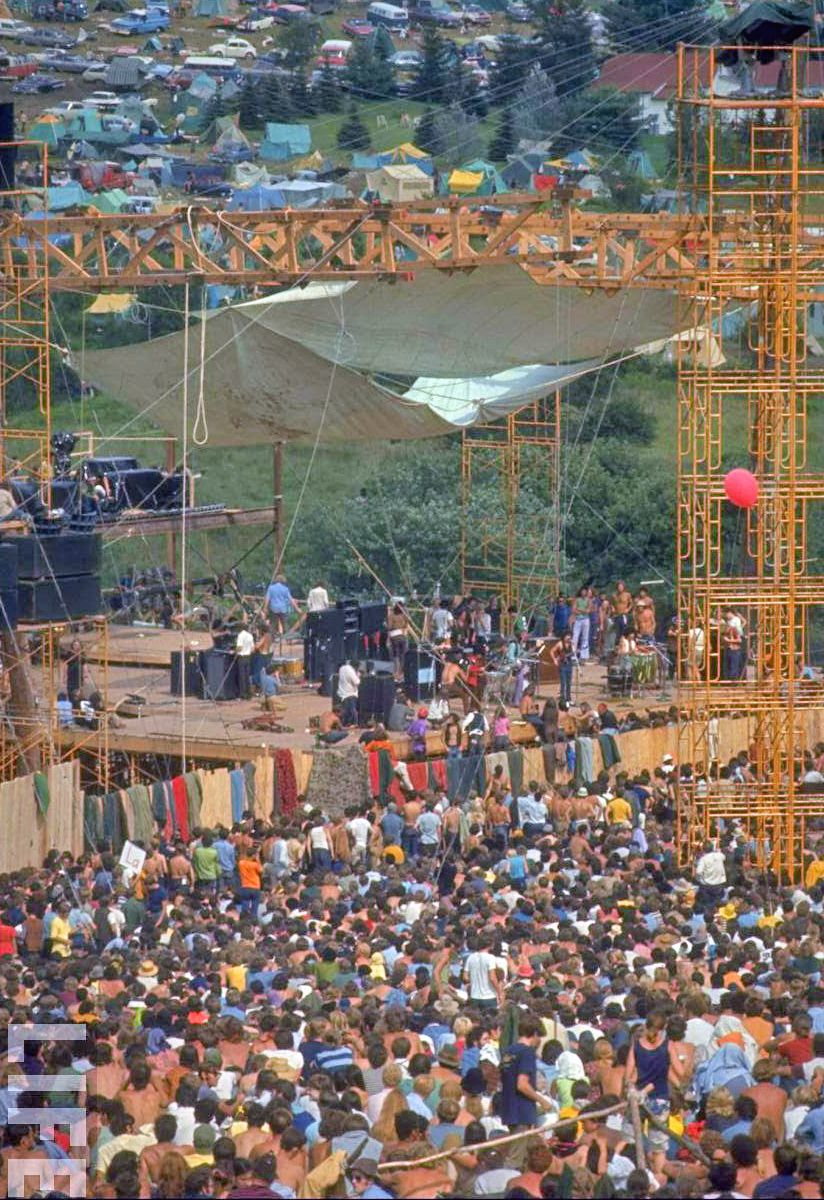 Photo showing large crowd and part of the stage at Woodstock