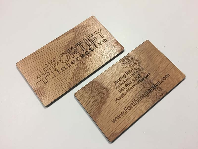 Laser engraved business cards on wood metal and plastic carry a laser engraved business cards on wood metal and plastic carry a work of art reheart Images