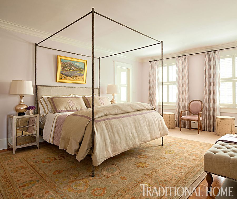 A calming neutral bedroom offers pops of