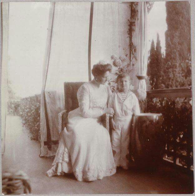 Empress Alexandra Feodorovna of Russia and Tsarevich Alexei Nikolaevich Romanov of Russia on the balcony of the Old Palace at Livadia in 1909.A♥W