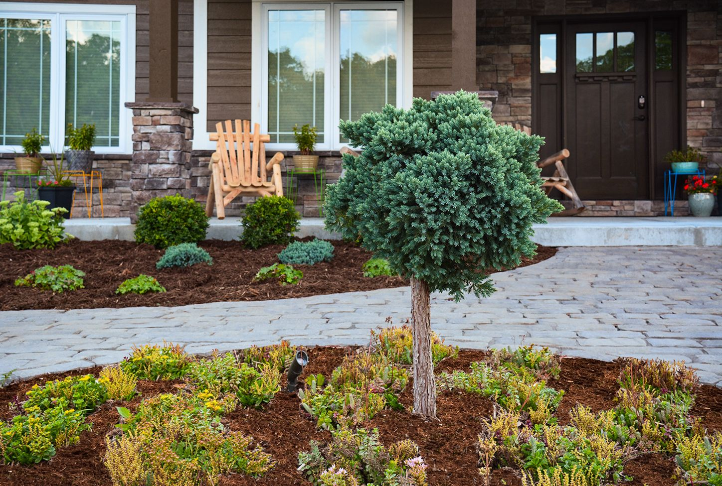 cobblestone walkways, different plant beds makes for a smooth and easy walkways for the homeowners and guests. All landscaping done by McKay nursery.