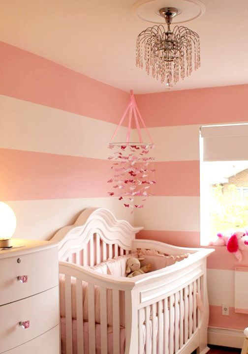 When you're designing a nursery or bedroom for your little girl, a simple color combination of pink and white will create a cheerful feminine space for her to enjoy. Paint vertical stripes on the walls with BEHR paint to truly transform the space into a girly getaway in your home.