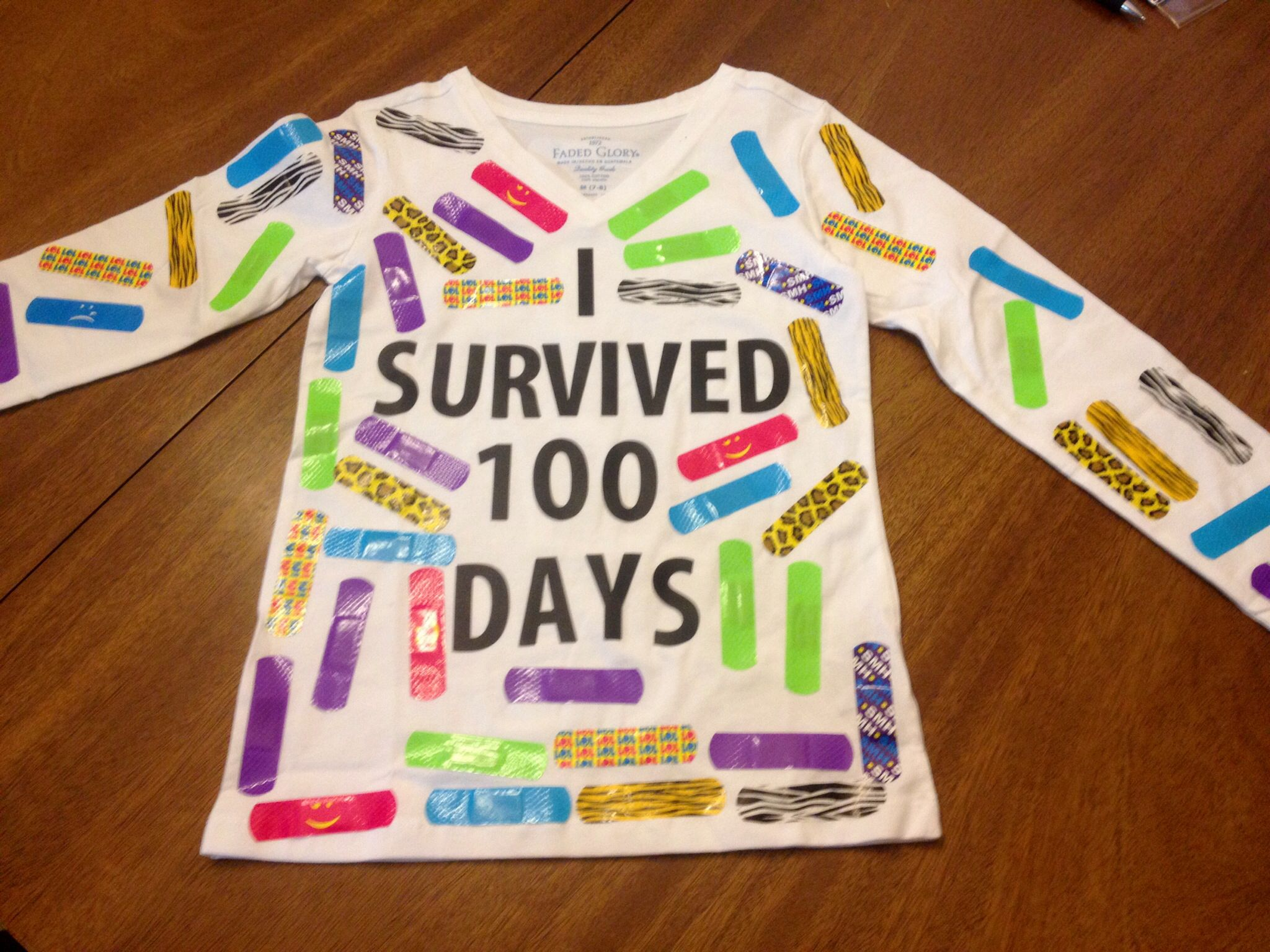 letters 100 days of school tshirt with 100 colorful band aids used vinyl peel and stick
