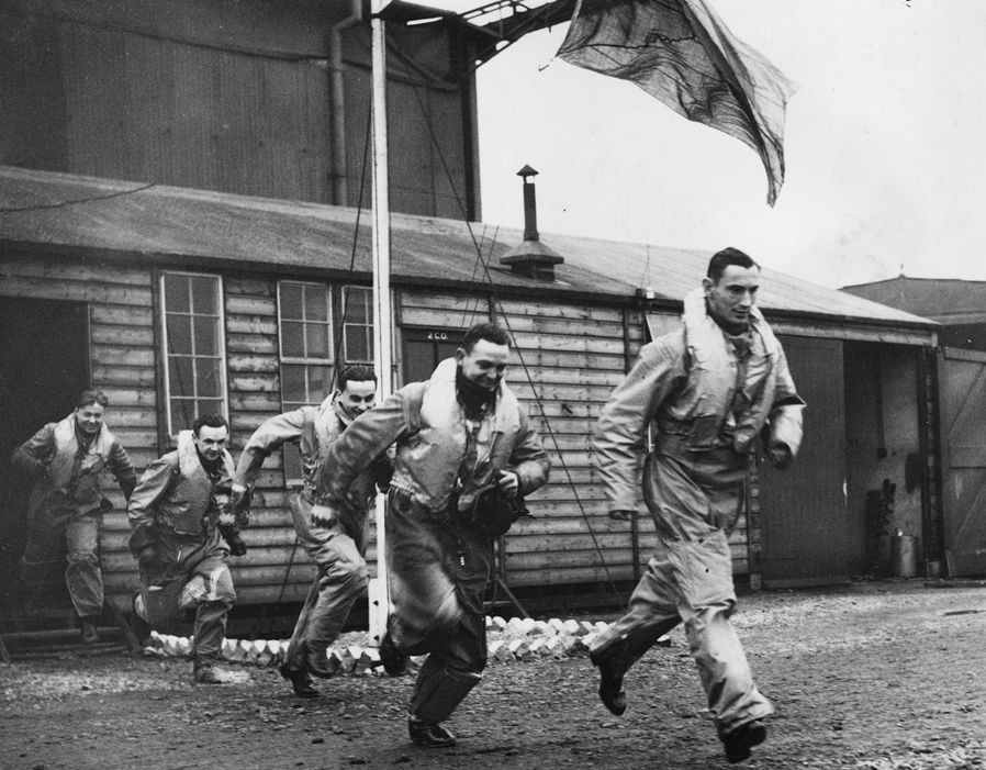 Pilots of No 312 Squadron RAF mock a scramble after receiving an alert at RAF Duxford in 1940. The Czech fourth in line has been identified as Sgt Jan Truhlář, who was posted in on 5 September with 1 and 1 shared destroyed with GC II/4 in France in early June. Formed at the No 12 Group sector station on 29 August, the squadron remained at the airfield until 26 September, when it moved to RAF Speke to provide defensive cover over the metropolitan county, with a detachment at RAF Penrhos.
