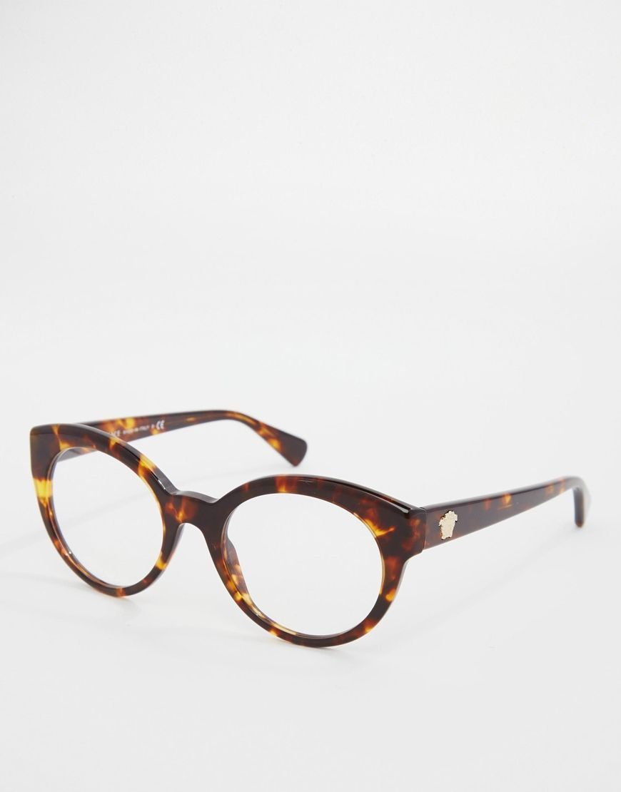 bfc22d3b1c Glasses by Versace Tortoiseshell frames Moulded nose pads for added comfort  Clear lenses Branded arms with curved temple tips for a secure fit These  frames ...