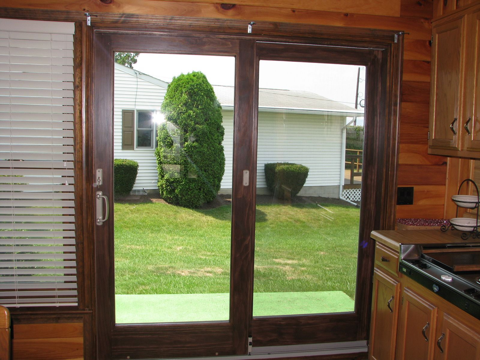 The Andersen Perma-Shield® sliding patio door has a rigid vinyl ...