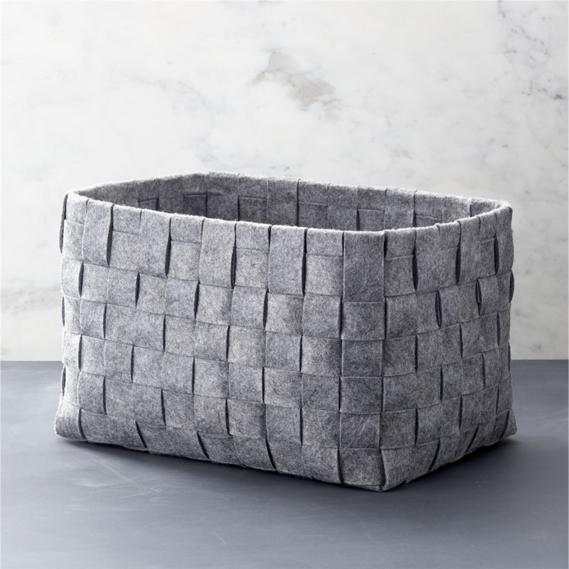 Woven gray felt basket for under hallway shelves