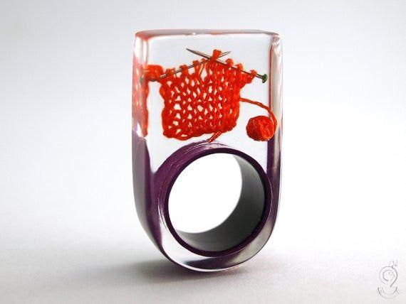 Strickzeug Außergewöhnlicher Strick-Ring mit orange-rot