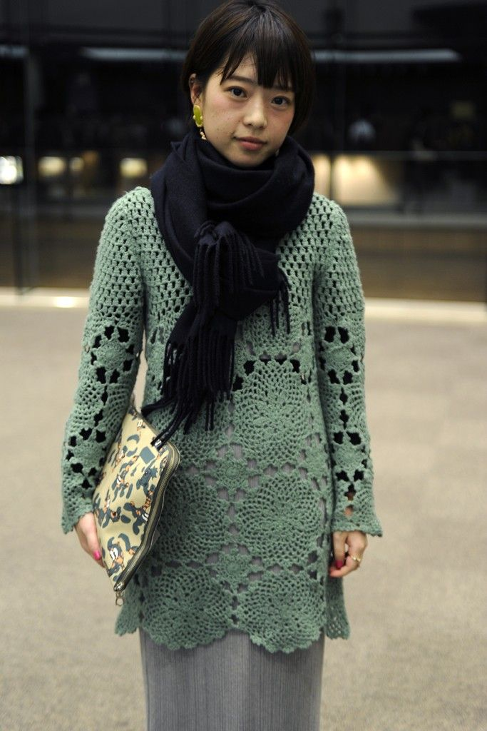 Crochet tunic and scarf over a simple maxi skirt and tee shirt. I don't like cartoon characters on my fashion accessories, but her clutch works. They Are Wearing: Tokyo Fashion Week WWD.com