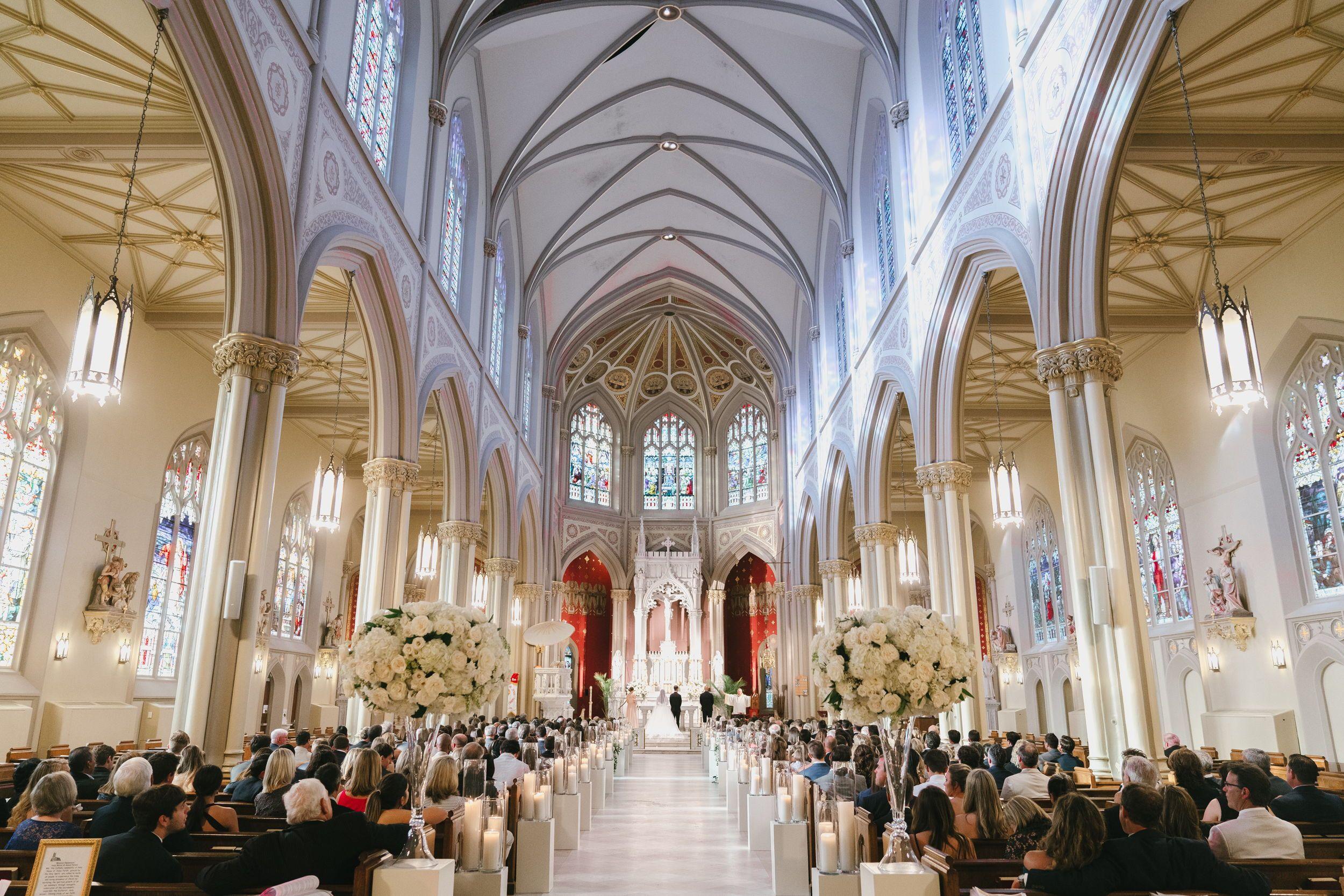 Traditional wedding ceremony inside Holy Name of Jesus
