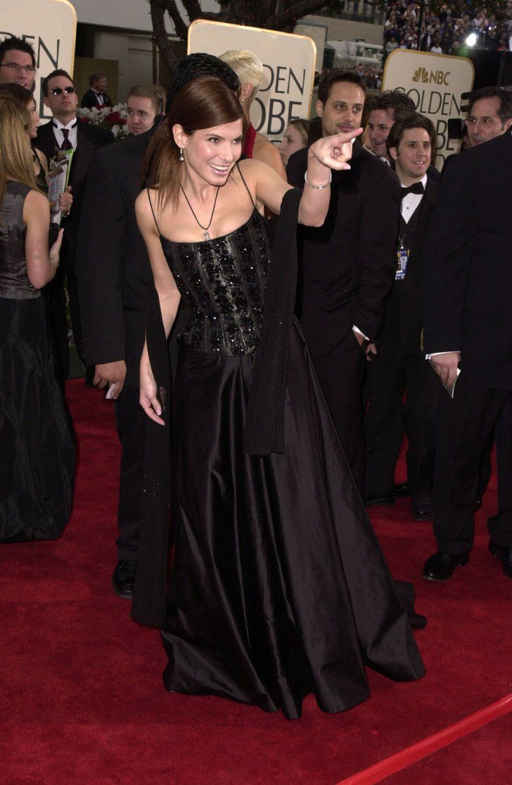 Pin for Later: A Look Back at Years of Glamorous Golden Globes  Sandra Bullock got playful on the red carpet in 2001.