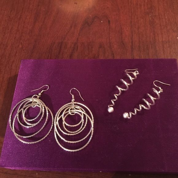 """TWO PAIRS OF STERLING SILVER DANGLING EARRINGS The multi-hoops pair measures 2 1/2"""" from post to the bottom of the lowest circle. The swirl earrings are 2 1/2"""" long. Jewelry Earrings"""