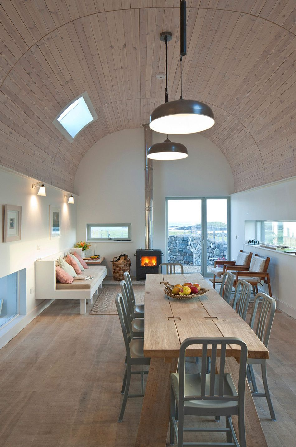 interior of modern curved roof house in Scotland by architect Murray Kerr of Denizen Works