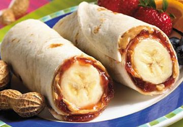 Banana, PB&J all rolled up. There is so much flavor here that you can use a multi-grain tortilla and the kids will still eat it.  I like these with a little drizzle of honey and sunflower seeds.