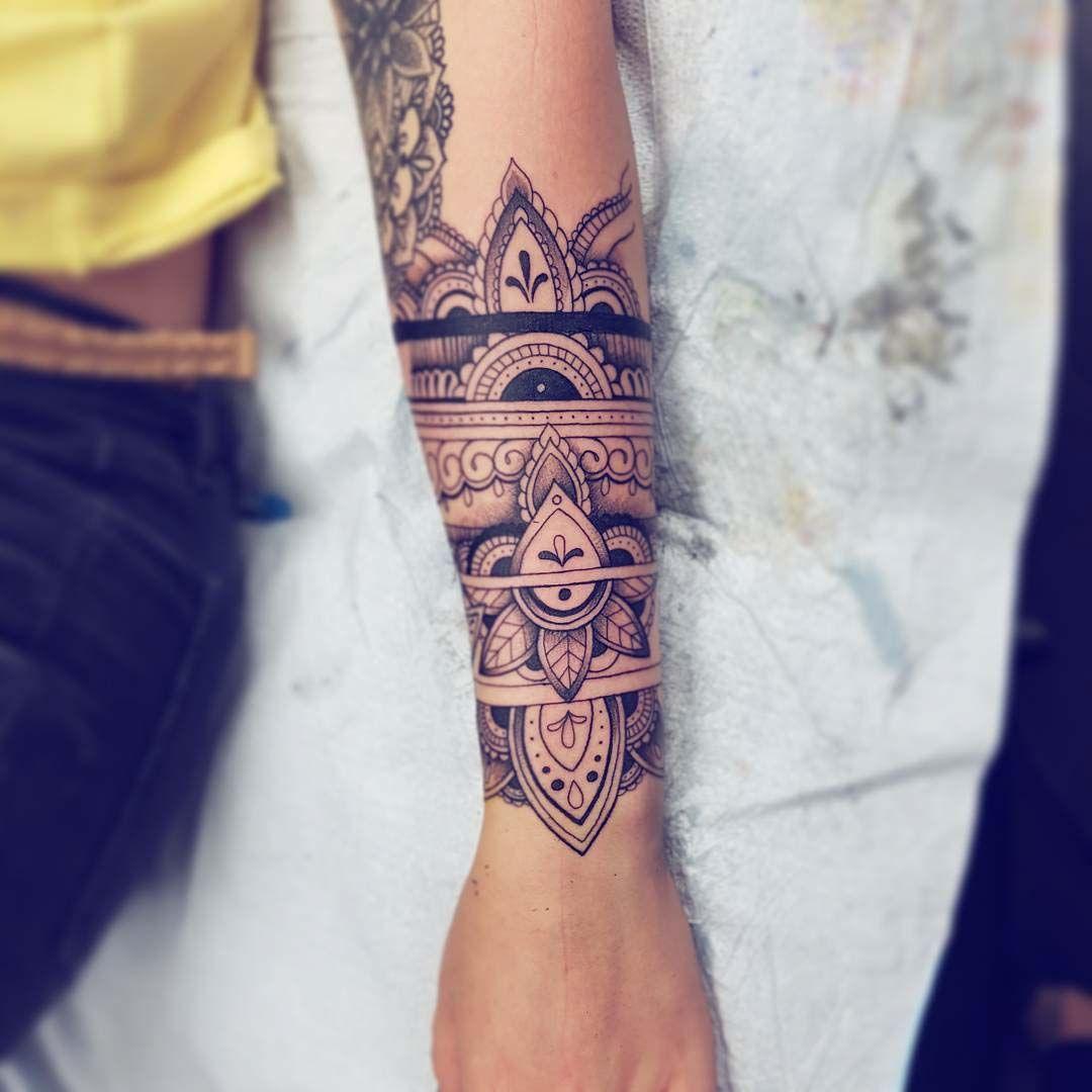 Ornamental Bracelet Tattoo On The Left Wrist Tattoo: Arm Band Tattoo
