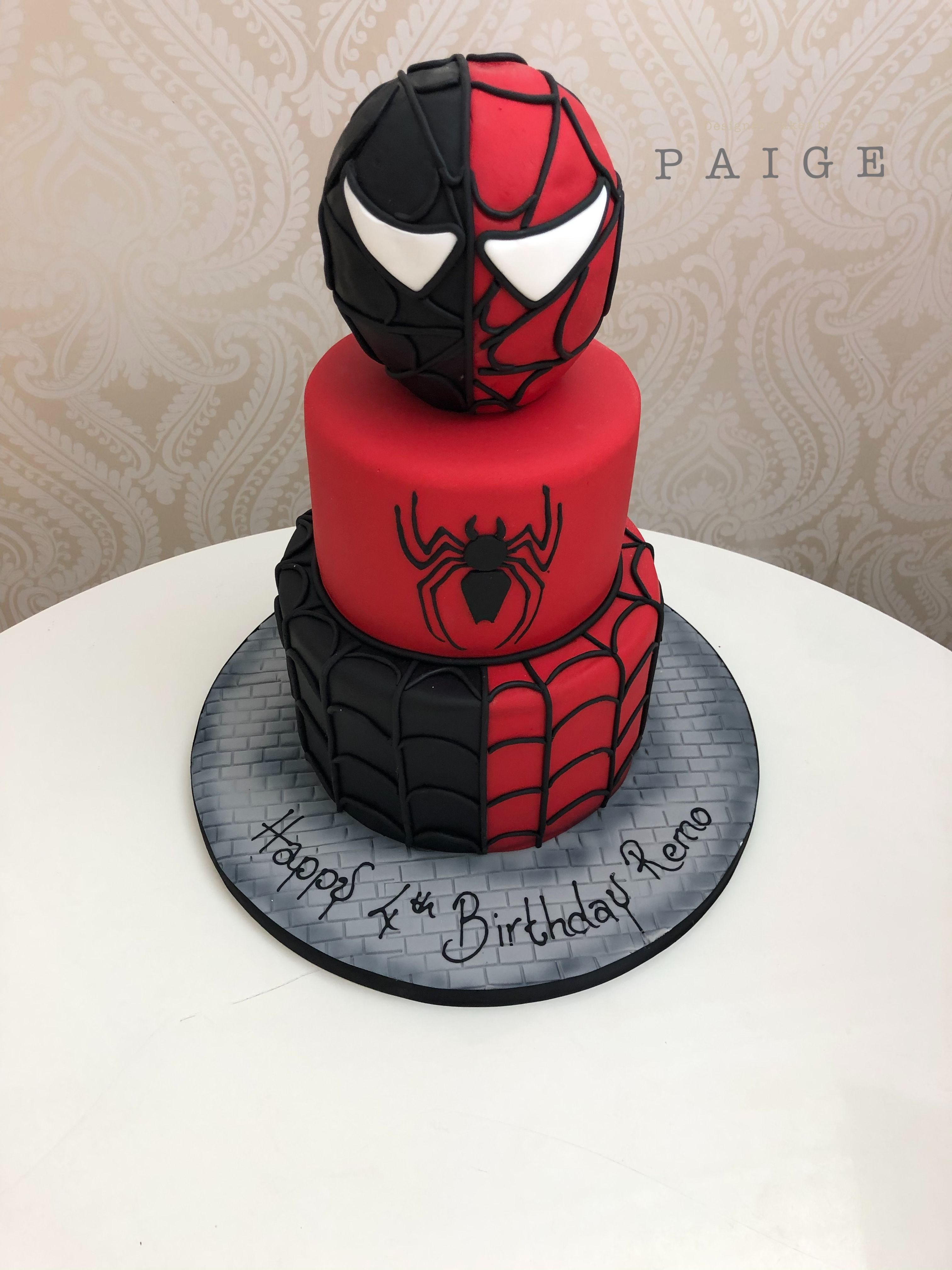 Black and red SpiderMan cake with spider logo, boys