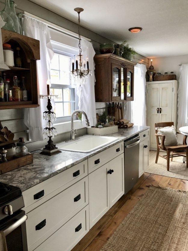 White shaker kitchen with random antique top