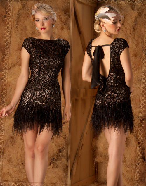 Lace with feather and open back. I need this. Gorgeous!