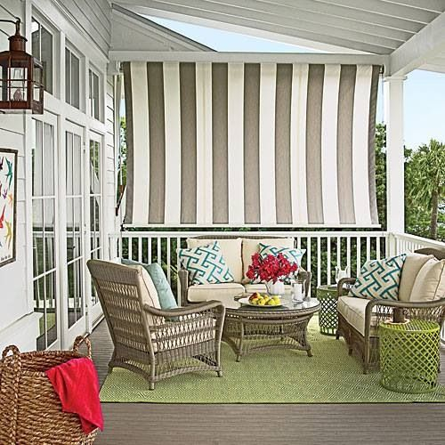 Backyard Patio Uses Striped Sunshade Mounted Vertically To Block Sun And Wind From Seating Area When Pulled Down Great Idea