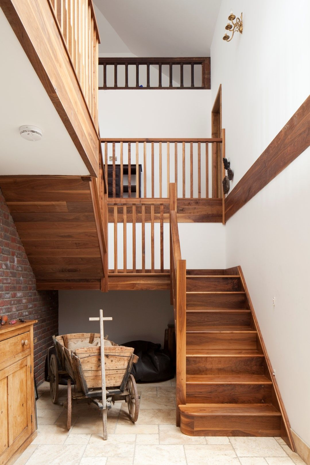 open timber stairs gallery landing double height space