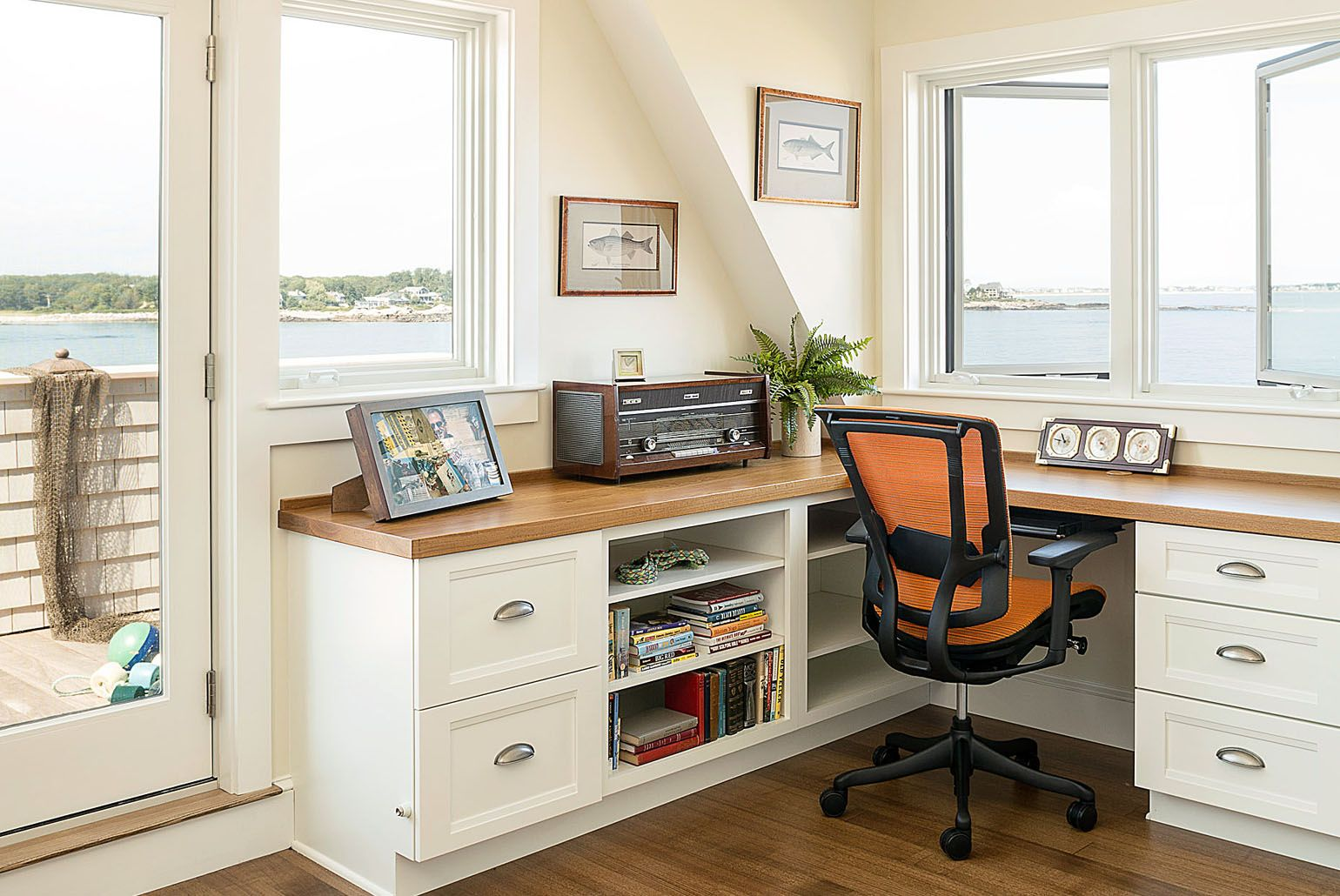 A built-in corner desk in the second-floor office offers a choice of ...