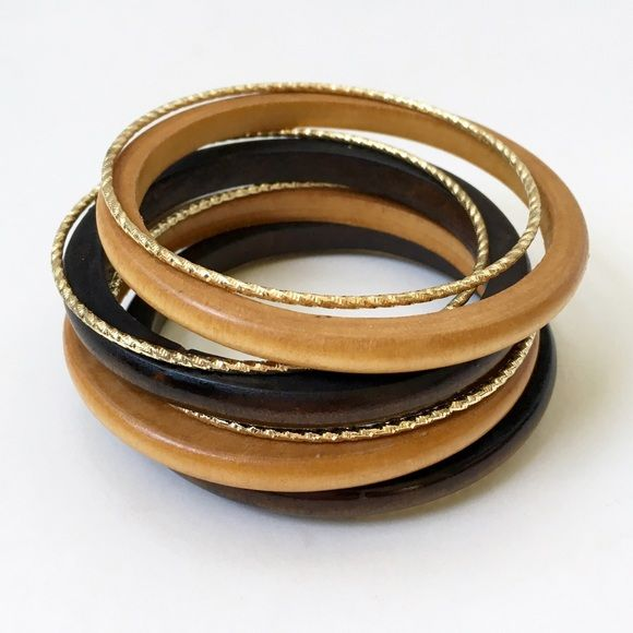 Set of Wood & Gold Bangles Four wooden bangles and four skinny gold bangles. Lightweight. Fun, fashion jewelry. I love to introduce wooden accessories into my wardrobe this time of year.❤️ Jewelry Bracelets