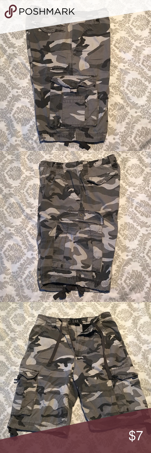 4079adcd0a Used CSG (Champs Sport Gear) men's black and white and camo cargo shorts.  Used. Size 32. Drawstring at waist and at the inseams. CSG Shorts Cargo