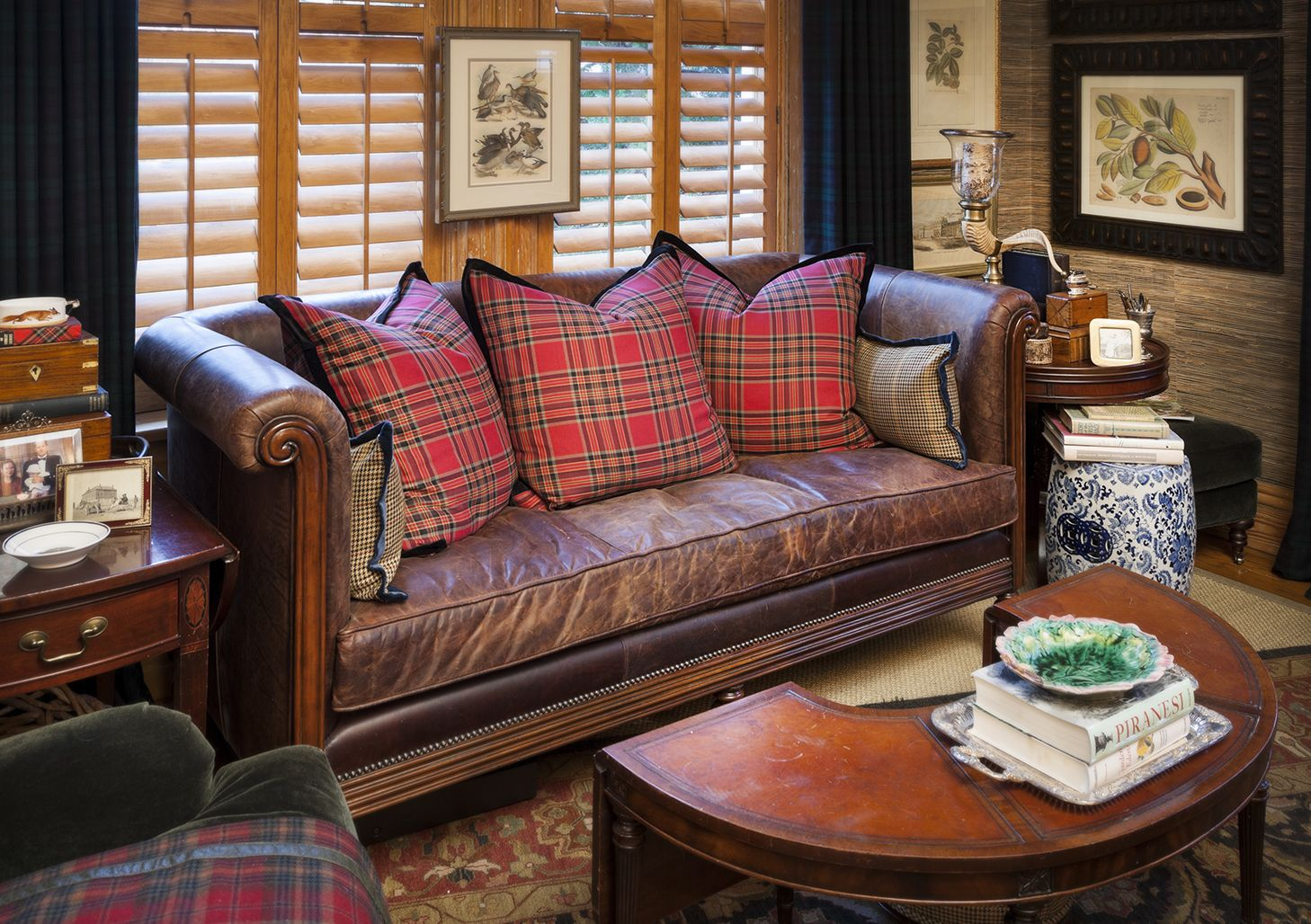 Classic brown leather sofa/settee with single seat cushion and tartan throw pillows - Nell Hill ...